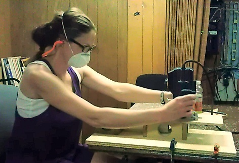 This is me using the jig that Bill D made for shaving a flat surface into the edge of the PVC pipe using a router.
